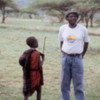 Maasai, Tanzania.: A boy talking with one of our guides