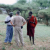 Maasai, Tanzania.: A cattle herder talking to our guides