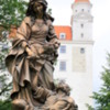 Bratislava -- St. Elizabeth statue: Elizabeth was a 13th century princess who was raised in Bratislava Castle, seen in the background. When her husband died she took a vow of poverty and devoted her life to the service of others.