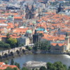 View of Old Town Prague from Petrin Tower: An overview including the historic Charles Bridge and Vltava River