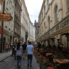 Prague -- A Walk on Karlova Street: The tower leading to Charles Bridge lies in the distance.