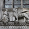 Venice -- Doge Palace entrance details: A detail of the entryway, the leader kneeling before the winged lion, symbol of Venice