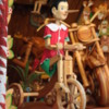 Pinocchio riding a tricycle, Woodcarver's shop, Florence, Italy