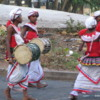 Parade in Colombo: Boys in traditional costumes with drums.