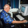 "Arthur C. Clarke as I often remember seeing him.: An e-mail addict, sitting at his desk dealing with ""the global village"" he'd envision many years earlier"