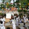 Anuradhapura -- Bodhi tree: Prayer flags and pilgrims