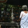 Anuradhapura -- Bodhi tree: Pilgrims burning incense and praying