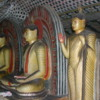 Dambulla -- interior Buddha statues: The cave walls are beautifully painted.
