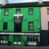 Ryan's Bar, Kenmare: Love the green color and Guinness promo