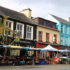 Colorful shops of Kenmare: Some of the Market stalls are in the foreground
