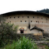 Yuchanglou, a 700 years old rotunda tulou in Yongding county.: Photo courtesy Wikipedia.  Taken by Gisling