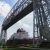 Aerial Lift Bridge, Duluth, Minnesota: Bridge raised with freighter passing underneath.
