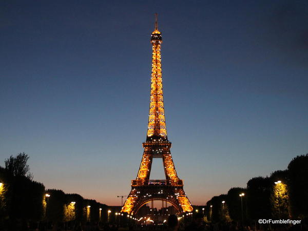Eiffel Tower lite up at Dusk, photographed from Champ de Mars