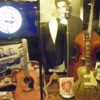 """Sun Studio museum exhibit: Elvis Presleys guitar, Bill Blacks upright bass, Scotty Moores guitar, and a jacket Elvis wore on the """"Dorsey Brothers Stage Show"""" January 28, 1956"""