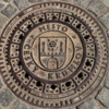 Cesky Krumlov 065.  Man Hole Cover