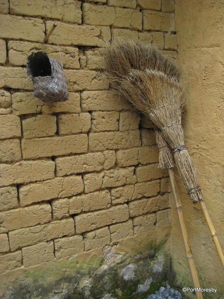 Broom with bird nest.
