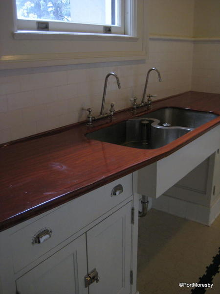 Kitchen with intriguing sink design.