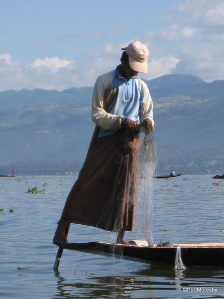 Leg rowing fisherman.