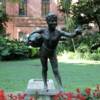 Buenos Aires, Jardin Botanico: One of dozens of statues in the park.  Not sure if this one is offering water or mate.