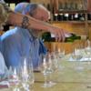Wine tasting, La Tienda de Vinos, El Calafate: The tattooed arm belongs to our guide, Mauro