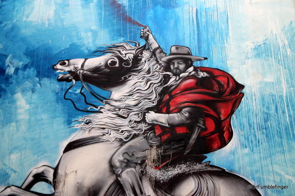 """Street art in the Colegiales barrio. This of a """"spray painting gaucho"""""""