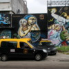 """Street art on the walls of a power plant in the Colegiales barrio.: Note all the """"Radio Taxis"""".  A cheap and safe way to get around Buenos Aires."""