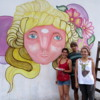Three street artists creating street art on Charcarita walls.