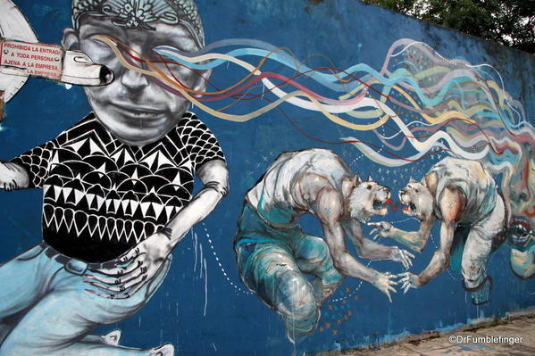 Street art on Charcarita walls. Tiger-Football player hybrids by Jaz
