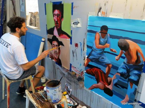 Street art in Villa Crespo. Jaz painting in his studio
