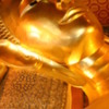 Reclining Buddha, Wat Po, Bangkok, Thailand: Close-up of the face resting on his right hand