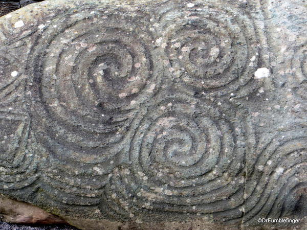 Triple swirl design at the entrance to the tomb is of unknown significance