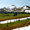 Sunshine Meadows.  The snow persists into July.: Mt. Assiniboine peaks over the top