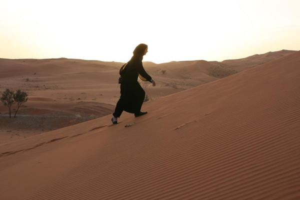 Saudi Arabia Riyadh, Climbing the Sands in an abaya