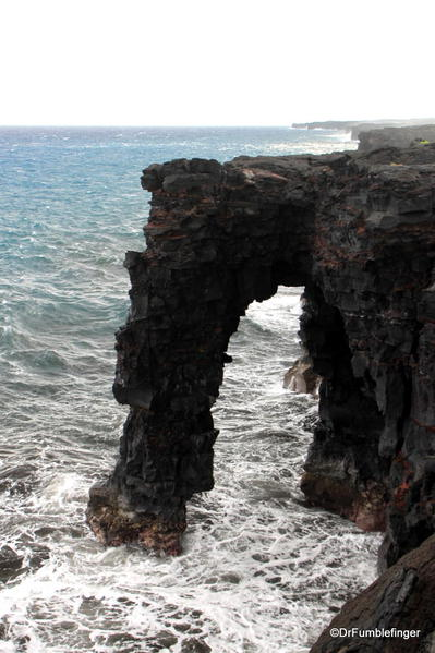 Volcanoes National Park. Holei Sea Arch: a natural arch, pounded by the powerful surf. Chain of Craters Road