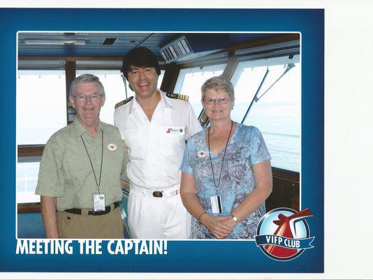 Bernard and Janice Caffary post on the bridge of Carnival Sensation (Photo courtesy Carnival Cruise Line)