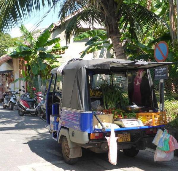 Vegetables being sold from a car, Galle