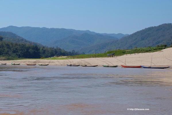17). Fishing boats on the Mekong