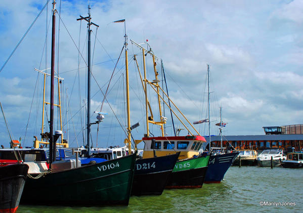 Sailing vessels are moored in Volendam's harbor