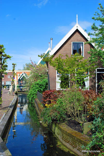 Picturesque houses line narrow canals in Volendam