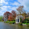 Historic tea houses line a canal in Edam.