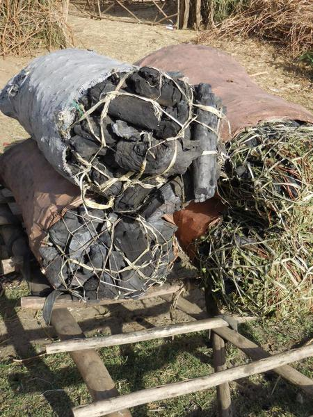 The farmers create charcoal out of wood