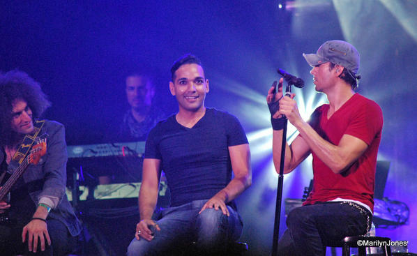 Enrique Iglesias (right) invited a fan to sing with him on stage.
