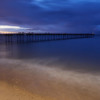 Beach and pier - glimmers of sunset.