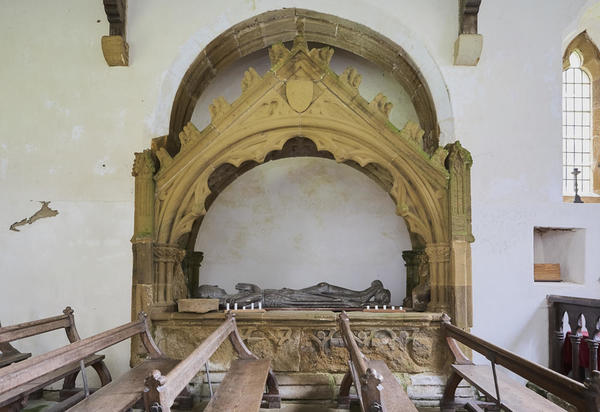 Effigy in tomb surrounds.