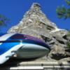 Disneyland Monorail passes by the Matterhorn.