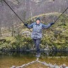 Ian Cook crossing the bridge to Steall Waterfall, Glen Nevis