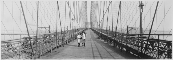 Pedestrians_on_the_upper_deck_promenade_of_Brooklyn_Bridge,_New_York_City,_ca._1910_-_NARA_-_541908.tif