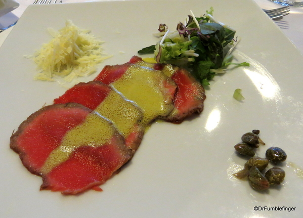 04 Beef Carpaccio, with dijon mustard dressing, Parmesan cheese, capers & artichokes