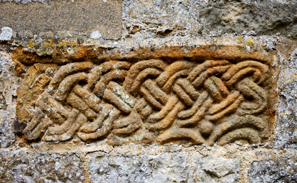 An ancient carving set in the minster exterior wall.