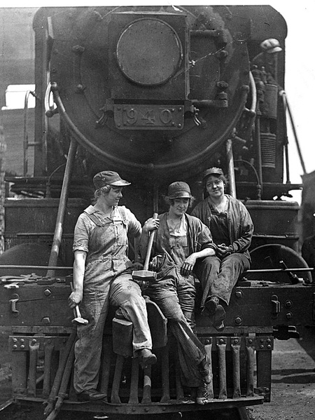 800px-Busch_(Bush)_Terminal._Women_Laborers_Seated_on_Front_of_Engine_in_Railroad_Yard_(3904009156)